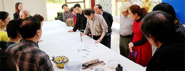 北京南北书画院理事长一行应邀到四川南充调研